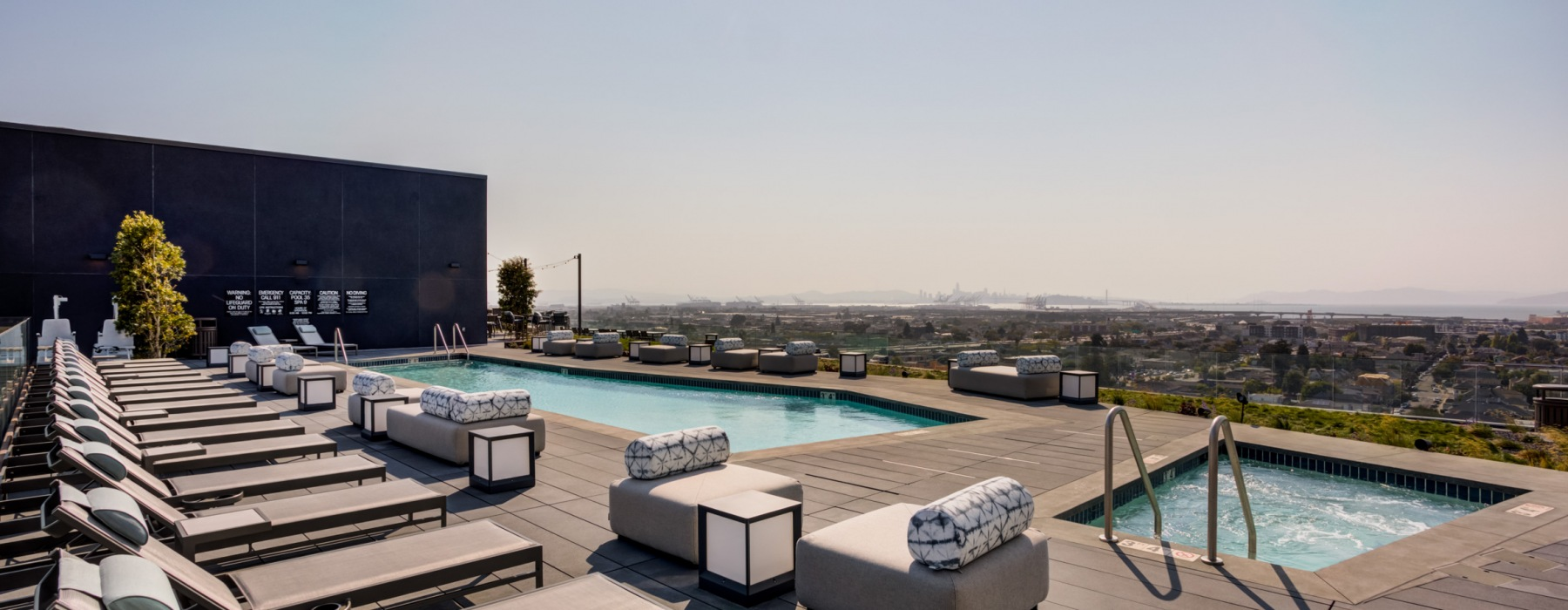 Outdoor pool and jacuzzi on the 15th floor overlooking the Oakland and San Francisco skylines