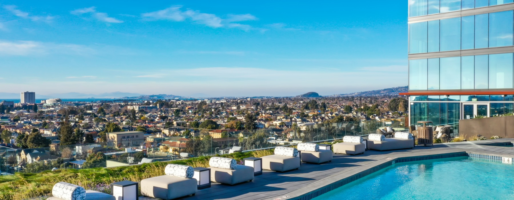 Landscape View from the pool of The Skylyne at Temescal. Clear blue skies with the cityscape views Berkeley and the bay.