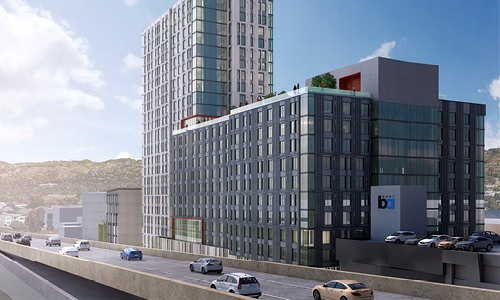 skylyne highrise exterior next to freeway with Oakland views